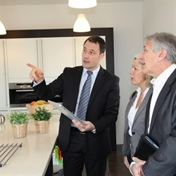 real estate agent showing buyers around home