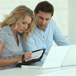 couple working online