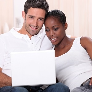 couple searching for new home online